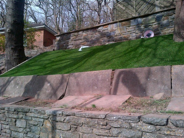 artificial grass fitted on a slope in a garden in Bridgend
