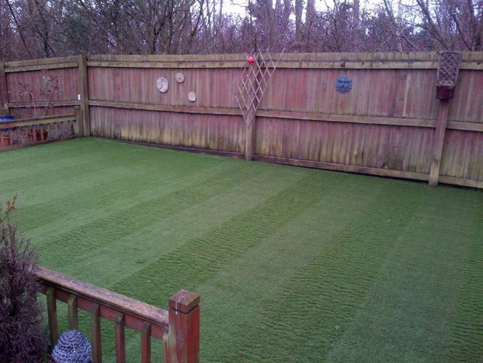 realistic stripped effect fake grass fitted in South Wales