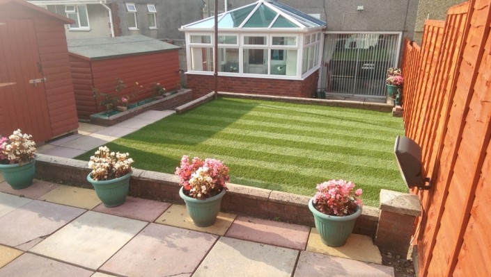 realistic fake grass installation in a garden in Cardiff for a South Wales cllient