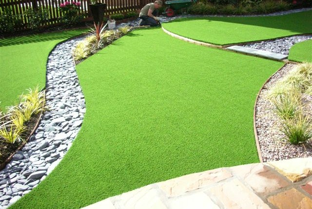 layered custom fitted artificial grass featured garden in Taffs Well
